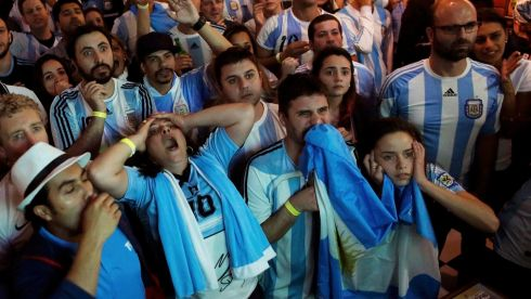Argentina fans react to a broadcast of the 2014 World Cup semi-final soccer match between Argentina and the Netherlands at the Mooca neighbourhood bar in Sao Paulo, Brazil. Photogrraph: Nacho Doce/Reuters