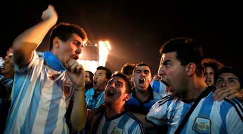 Feel the roars of the Argentinian soccer fans.  Photograph: Pilar Olivares/Reuters
