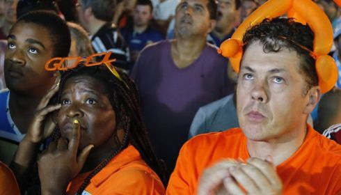 Gloom: Fans of the Netherlands watching the defeat to Argentina. Photograph: Abedin Taherkenareh/EPA