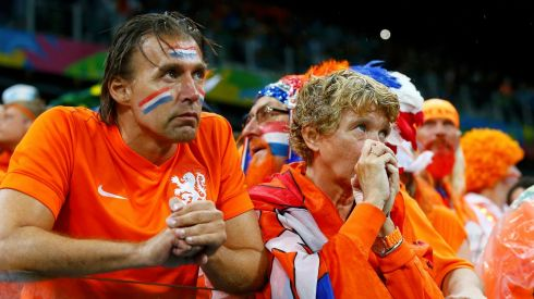 Netherlands fans dejected in Sao Paolo after the semifinal loss. Photograph: Darren Staples/Reuters