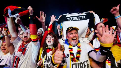 German fans enraptured in front of the Brandenburg Gate as their side rout the Brazilians 7-1 in the World Cup semi-final. Photograph: Daniel Bockwolt/EPA