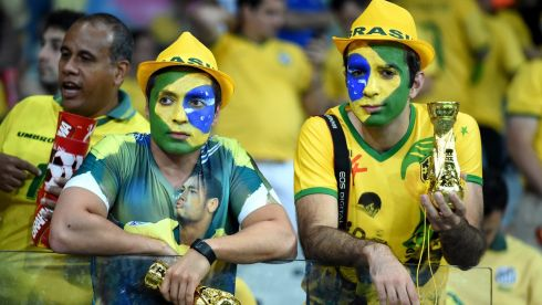 Brazilian fans show their dejection after the 7-1 loss to Germany in the semifinal at the Estadio Mineirao in Belo Horizonte, Brazil. Photograph: Marcus Brandt/EPA