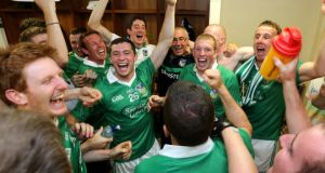 Limerick players celebrate in the dressing room with manager John Allen after their championship success at Gaelic Grounds in Limerick last year where Cork were beaten. Photograph: James Crombie/Inpho