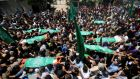 Grieving: the funeral of eight members of the Palestinian al-Haj family, killed in an early morning air strike. Photograph: Ibraheem Abu Mustafa/Reuters