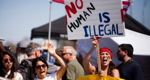 Demonstrators picket before the possible arrival of undocumented migrants who may be processed at the Murrieta Border Patrol Station in Murrieta, California. Photograph: Reuters