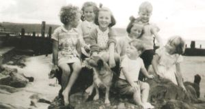 Sheelagh Coyle and her cousins, sisters and brother on the front strand in Youghal in the late 1950s