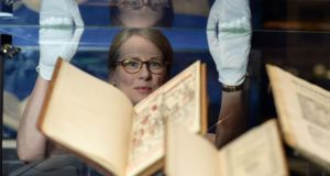 Director Fionnuala Croke with ancient books at the Chester Beatty Library in Dublin for the exhibition of rare works, A to Z, From Amulet to Zodiac, which opened yesterday. Photograph: Frank Miller