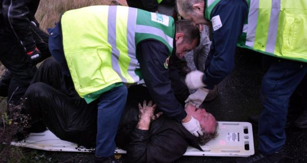 A man injured during protests against Shell's inland gas refinery at  Bellanaboy, Co Mayo, in November 2006 is removed by ambulance. Photograph: Eric Luke.