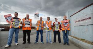 Greyhound workers Gordon Richardson, Donnacha O'Cinneide, Paul Stapleton, Joe Hall, Michael McNamara and James Simpson outside the company's buildings at Clondalkin Industrial Estate. Photograph: Alan Betson