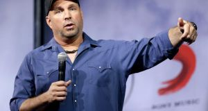 Country music star Garth Brooks speaks at a news conference in Nashville yesterday. Photograph: Mark Humphrey