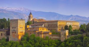 Alhambra Palace (above), beyond which lie the Sierra Nevada and  Alpujarras