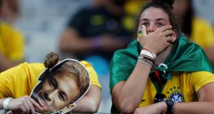 Fans of Brazil react after their loss to Germany in their 2014 World Cup semi-finals at the Mineirao stadium in Belo Horizonte. Photograph: Reuters