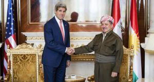 Massoud Barzani with US secretary of state John Kerry. Photograph: AP