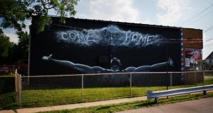 "A mural of LeBron James reads ""come home"" on the side of a barbershop in Cleveland. Photograph: Dustin Franz/New York Times"