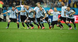 Argentina players celebrate after their Maxi Rodriguez scored the decisive goal during a penalty shoot-out against the Netherlands at the 2014 World Cup semi-finals at the Corinthians arena in Sao Paulo.