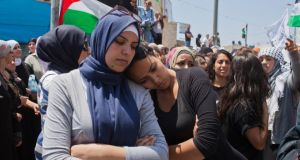Palestinians mourn for Palestinian teenager Muhammad Hussein Abu Khdeir, outside his home in Jerusale last week. Photograph: Rina Castelnuovo/The New York Times