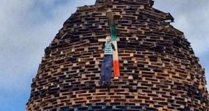 "Sinn Féin president Gerry Adams has described the image of a lynched figure on a bonfire at Ballycraigy on the outskirts of Antrim Town as ""deeply offensive and a clear hate crime by those responsible""."