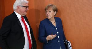 "German foreign minister Frank-Walter Steinmeier with chancellor Angela Merkel: Mr Steinmeier struck a more conciliatory tone and described Berlin's partnership with Washington as ""without alternative"". Photograph: Adam Berry/Getty Images"