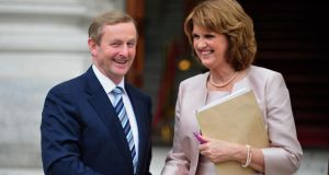 Taoiseach Enda Kenny and Tánaiste Joan Burton  after their first joint press conference yesterday. Photograph: Aidan Crawley