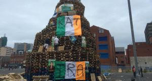 The bonfire pyre at Sandy Row covered in Irish tri colours and nationalist political posters. Photograph: Dan Griffin/The Irish Times