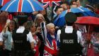 Loyalist supporters cheer on an Orange Order parade on Crumlin Road. Photograph:  Brian Lawless/PA Wire
