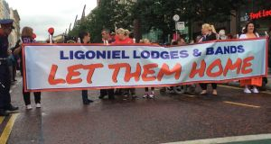 Marchers hold a banner calling for the Ligoniel Lodges Orange bands to be allowed march past the Ardoyne shops in north Belfast. Photograph: Dan Griffin/The Irish Times