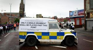 A police vehicle displays a sign outlining the rules of a parade by Loyalists and members of the Orange Order along Crumlin Road in north Belfast. Photograph: Cathal McNaughton/Reuters