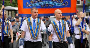 Members of the Orange Order parade through Belfast. Photograph: Kevin Scott/EPA