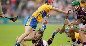 Wexford's Liam Óg McGovern collides with the knee of Clare's Jack Browne during the All-Ireland SHC Qualifier  Round 1 Replay at Wexford Park. Photograph:  Donall Farmer/Inpho