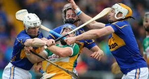 Offaly's Brian Carroll  has no room to move as the Tipperary trio of  Michael Cahill, Paddy Stapleton and Paudie Maher surround him during the All-Ireland SHC Qualifier at O'Moore Park in Portlaoise. Photograph: Cathal Noonan/Inpho