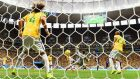 Daley Blind of the Netherlands scores his team's second goal past goalkeeper Julio Cesar and David Luiz of Brazil. Photograph:  Jamie McDonald/Getty Images