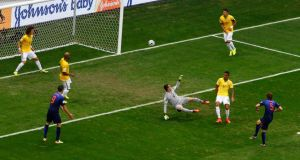 Daley Blind of the Netherlands scores past Brazil's goalkeeper Julio Cesarat the Brasilia National Stadium. Photograph: Ruben Sprich / Reuters