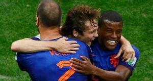 Daley Blind of the Netherlands celebrates his goal against Brazil with teammates Ron Vlaar (left) and Georginio Wijnaldum  at the Brasilia National Stadium. Photograph: Ruben Sprich / Reuters