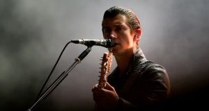 Vocalist Alex Turner of the Arctic Monkeys: lack of crowd interaction at Marlay Park last night suggests that he is still somewhat uncomfortable in the 'frontman' role. Photograph: EPA