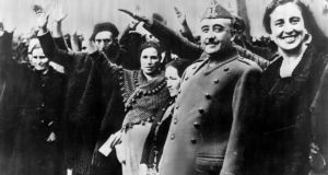 General Francisco Franco (second from right) and his wife Doña Carmen Polo are saluted at a reception at Burgos. Photograph: Keystone/Getty Images