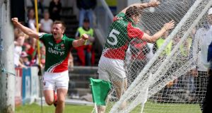 Mayo's Lee Keegan hits the back of the net after scoring a goal as Cillian O'Connor celebrates setting him up during the Connacht SFC Final at  MacHale Park in Castlebar.  Photograph: Donall Farmer/Inpho