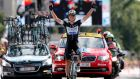 Omega Pharma Quick Step Procycling team rider Tony Martin of Germany celebrates as he crosses the finish line to win the ninth stage of the 101st Tour de France  from Gerardmer to Mulhouse. Photograph: Kim Ludbrook/EPA
