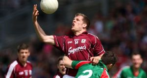 Mayo's Chris Barrett tackles  Eddie Hoare of Galway during the Connacht final. Photo: Ryan Byrne/Inpho