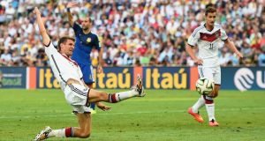 Thomas Müller of Germany stretches for a cross during the 2014 Fifa World Cup final between Germany and Argentina at Maracana in Rio de Janeiro. Photograph:  Laurence Griffiths/Getty Images