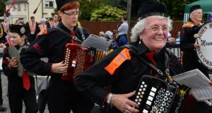 Music fills the air at the Twelfth of July demonstration in Markethill, Co Armagh, on Saturday. Photograph: Dara Mac Dónaill