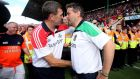 Cork manager Jimmy Barry Murphy greets  Limerick boss   TJ Ryan after the game. Photo: James Crombie/Inpho