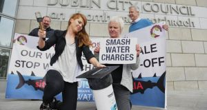Bríd Smith (second from right) at a water charges protest during the local election campaign with fellow People Before Profit candidates Paul Shields,  Kim O'Donnell and Andrew Keegan. Photograph: Aidan Crawley