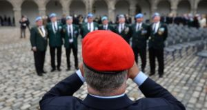 A red beret photographs some blue berets attending the annual National Day of Commemoration Ceremony to honour all  Irishmen and Irishwomen who died in past wars or on service with the United Nations. Photograph: Dara Mac Dónaill