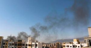 Smoke rises near buildings after heavy fighting between rival militias broke out near the airport in Tripoli yesterday. Photograph: Reuters/ Hani Amara