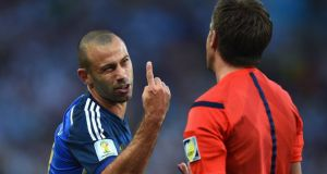 Javier Mascherano  voices his disagreement to referee Nicola Rizzoli during the the  FIFA World Cup final against Germany at the Maracana Stadium in  Rio de Janeiro. Photograph:  Laurence Griffiths/Getty Images