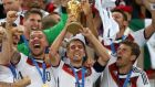 Philipp Lahm lifts the World Cup trophy with team-mates after final win over Argentina at the  Maracana. Photograph:  Mike Egerton/PA Wire