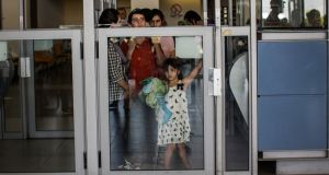 People wait to be let into Israel from Gaza during evacuations on the sixth day of Israel's operation 'Protective Edge' in Erez. Photograph: Andrew Burton/Getty Images