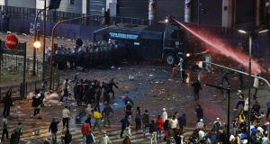 Rioters clash with police in Buenos Aires following Argentina's defeat to Germany in Sunday night's World Cup Final in Brazil. Photograph. Ivan Alvarado/Reuters