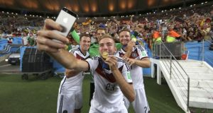 German players Christophe Kramer (C), Kevin Grosskreutz (L), Manuel Neuer (rear) and Shkodran Mustafi (R) take a selfie after winning the FIFA World Cup 2014 final. Photograph: Antonio Lacerda/EPA