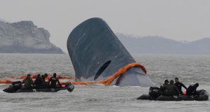 The Sewol ferry disaster in which 304 people died: the tragedy affected the economy. Photograph: AP/Ahn Young-joon